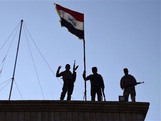 Iraqi troops advance in battle for key ISIS city
