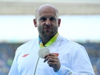 Olympian auctions his silver medal for sick boy
