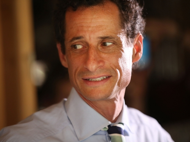 Clinton aide separates from scandal-plagued Weiner
