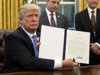 Trump hints at new immigration executive order