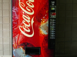 Vending machine delays unhealthy snack purchases