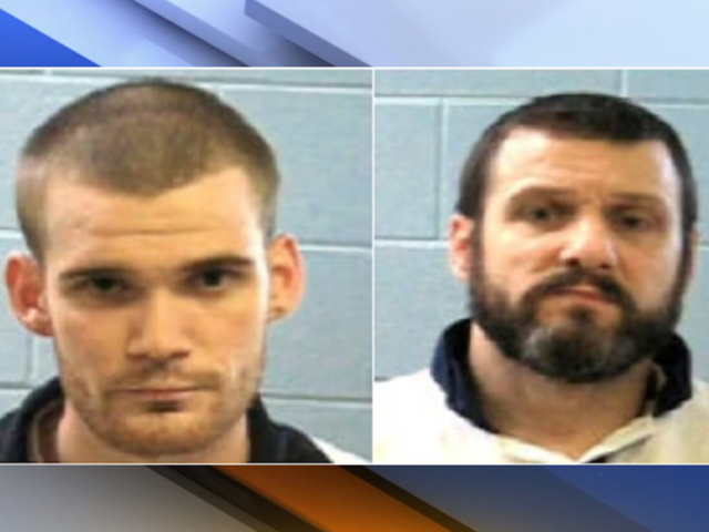 Georgia police hunt escaped inmates after two guards killed