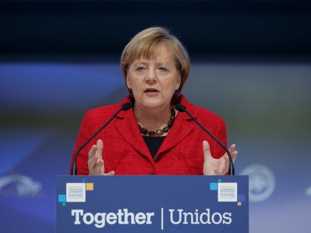 Merkel projected to remain German chancellor