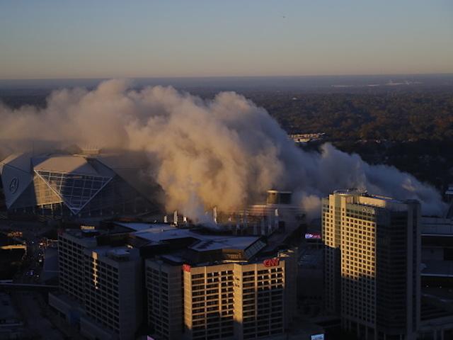 City bus photobombs network's coverage of stadium implosion